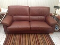 Two seater brown leather sofa.