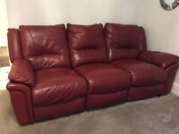 Claret coloured 3 seater twin recliner leather sofa.