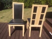 Dining Chairs. 4 matching light wood with black upholstery. Attractive backs.Excellent condition.