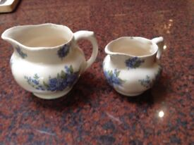 Pair of pretty pottery jugs