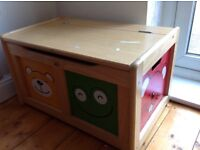 Children's storage box. Wooden box with characters.