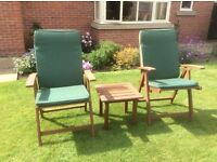 Two wooden garden chairs with cushions & small table