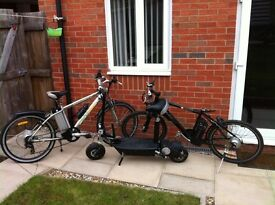 2 adult electric mountain bikes and 1 electric scooter