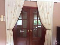 Cream curtains & 2 cream roller blinds