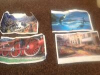 Four jigsaw puzzles.