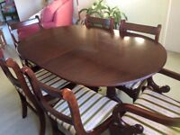 Mahogany effect extending dining table and six chairs