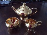 Royal Winton gold lustre teapot, cream jug and sugar bowl. Never used