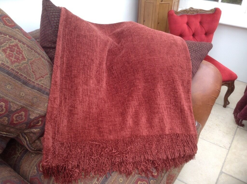 2 x matching soft John Lewis throwsin Lymington, HampshireGumtree - 2 x matching rich rust coloured throws. Very soft fabric. Excellent quality, creating a luxurious look. Collection only. £30