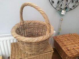 Very thick clunky long handled wicker round basket