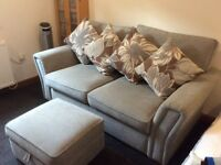 Large 2 seater sofa in grey with matching foot stool with storage