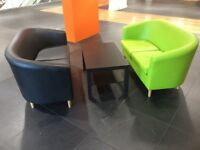 Black and Green sofas with black table.