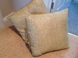 Gold sequin cushions