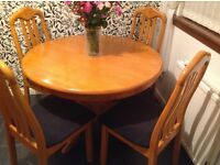 Round table with four matching chairs with cloth cushions base