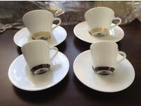 Genuine Nespresso coffee cups and saucers.