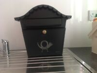 Green metal postbox