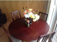 Dinning table for £40. brown color with four chairs.