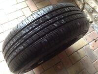 Part worn 205 / 65 R 15 Aplus 606 tyre with steel rim.