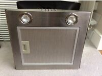 Kitchen chimney extractor unit with curved glass canopy