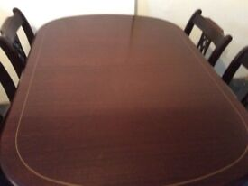 Reproduction Regency style extending ding table and 4 Chairs.