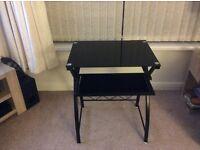 Black gloss computer table.
