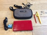Nintendo DS lite red with travel case 1x game