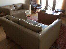 Cream leather two seater sofas