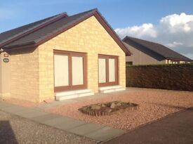 Modern 2 bedroom fully furnished house with garden, drive and garage within private housing estate.