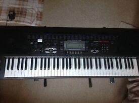 Casio WK-1300 Electric Keyboard/Stand & Sheet Music
