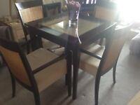 Leekes , beautiful dining table and 4 chairs. Mango wood and glass top. 4 stunning chairs cream seat
