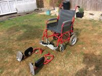 Wheelchair with extended leg supports