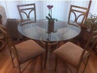 Round Glass topped Table with 4 High Backed Chairs