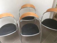Four modern stackable dining room chairs