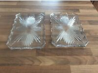 Two oblong glass dressing table plates.