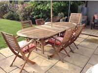 Solid wood Garden patio table and 6 folding chairs with armrests £175 Ono tel 07966921804