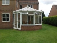 Large White PVC conservatory with leaded upper window detail for sale.