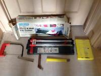 2 Tile Cutters, A Handsaw, 2 Cutters And a File.