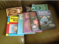 Large amount of lace making equipment includes books bobbins charts etc.