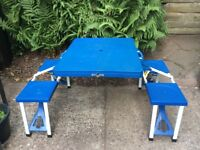 Camping table with 4 seats.