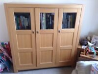 A bookcase cabinet,and a coffee table.