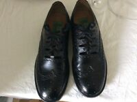 Size 8 black leather grille shoes