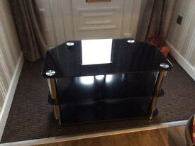 Three tier glass TV stand