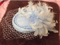 Baby blue vintage hat with net and feather