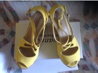 Woman's size 7 yellow wedged shoes boxed,vgc