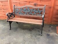 Decorative cast iron and wood garden bench. Five wooden slates. 4 foot 2 inches length. Decorative