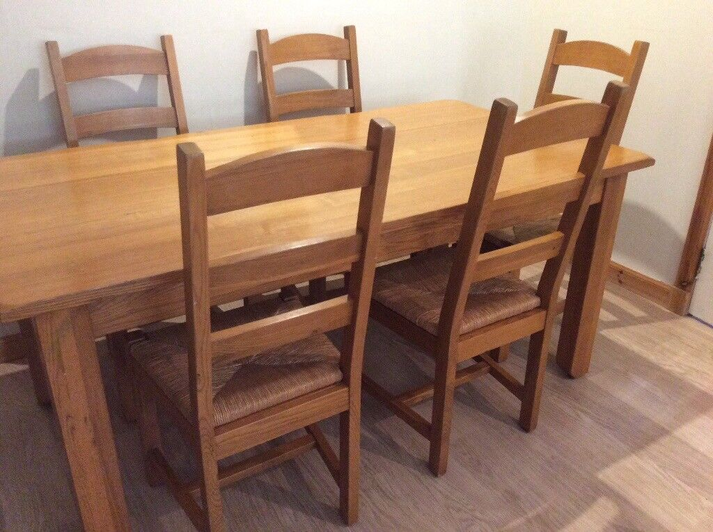 Solid Oak Dining Table With 6 Matching Chairs And A Coffee