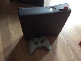 Xbox 360 with controller and 8 games