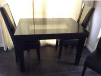 For sale black and cream leather table and chairs