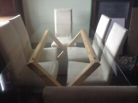 Glass dining table with 6 cream faux suede chairs
