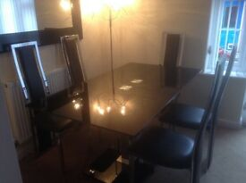 Stunning black and chrome dining room table and six chairs.