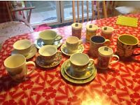 Range of mugs cups and saucers mixture of modern and vintage